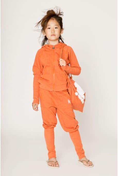 Shampoodle, orange-tracksuit