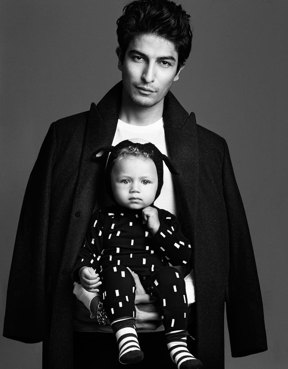 GentleMan by photographer Zoe Adlersberg & stylist Maria Walker. creating a series of striking black and white portraits of men with babies.
