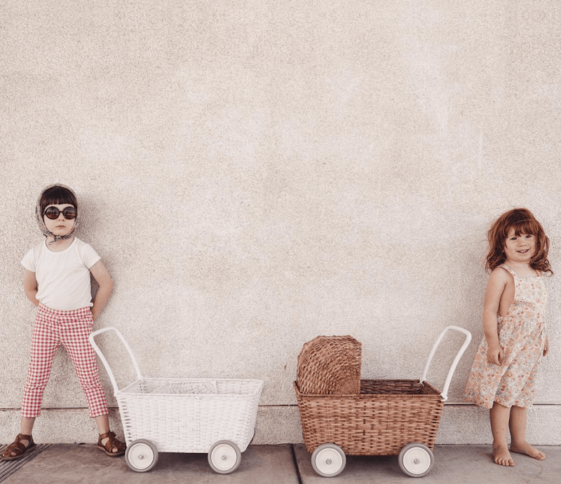 Olliella Strolly - Ahand-woven rattan basket on wheels that switches from a pram to a shopping trolley