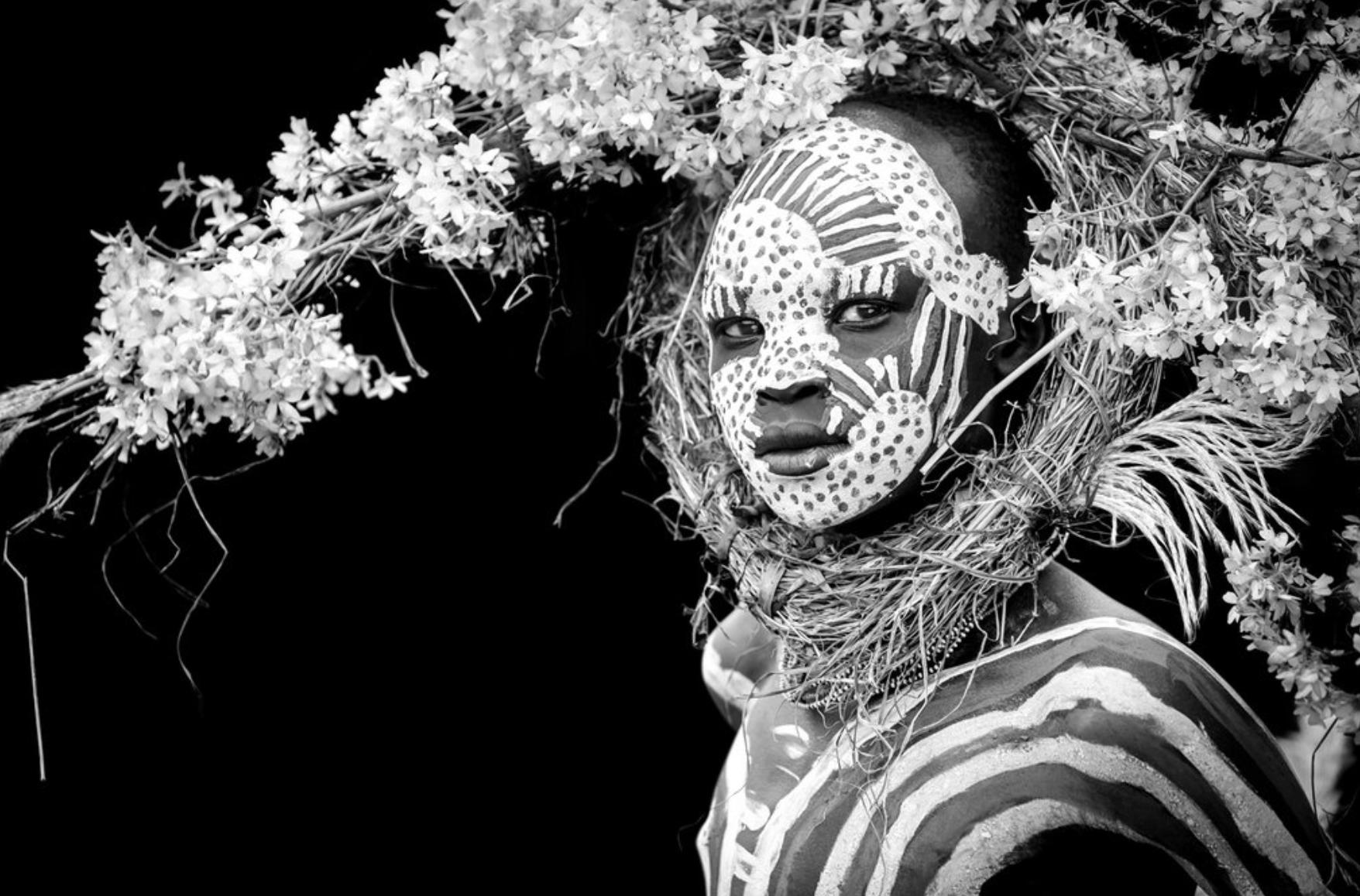 Giovanna Aryafara photography Suri Tribe. ABEBE - Suri boy with crown of flowers