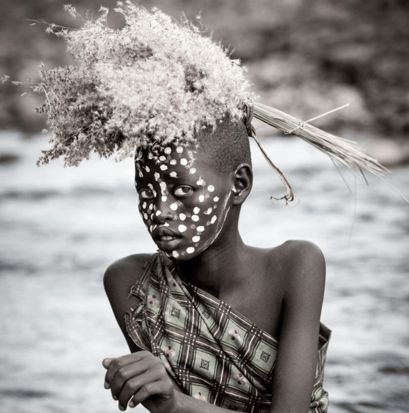 Giovanna Aryafara photography Young girl from the Suri tribe by The Omo river
