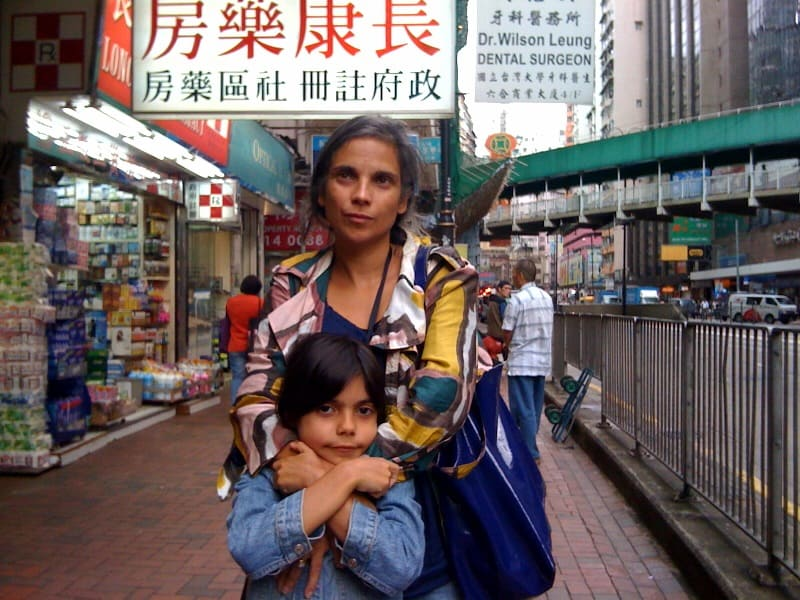 Nicole with daughter Maya, in the streets of Hong Kong