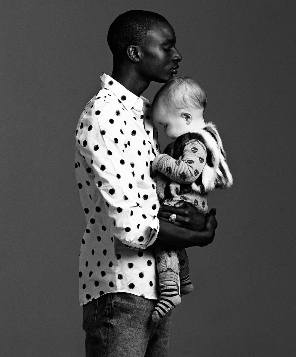 GentleMan by photographer Zoe Adlersberg & stylist Maria Walker. creating a series of striking black and white portraits of men with babies