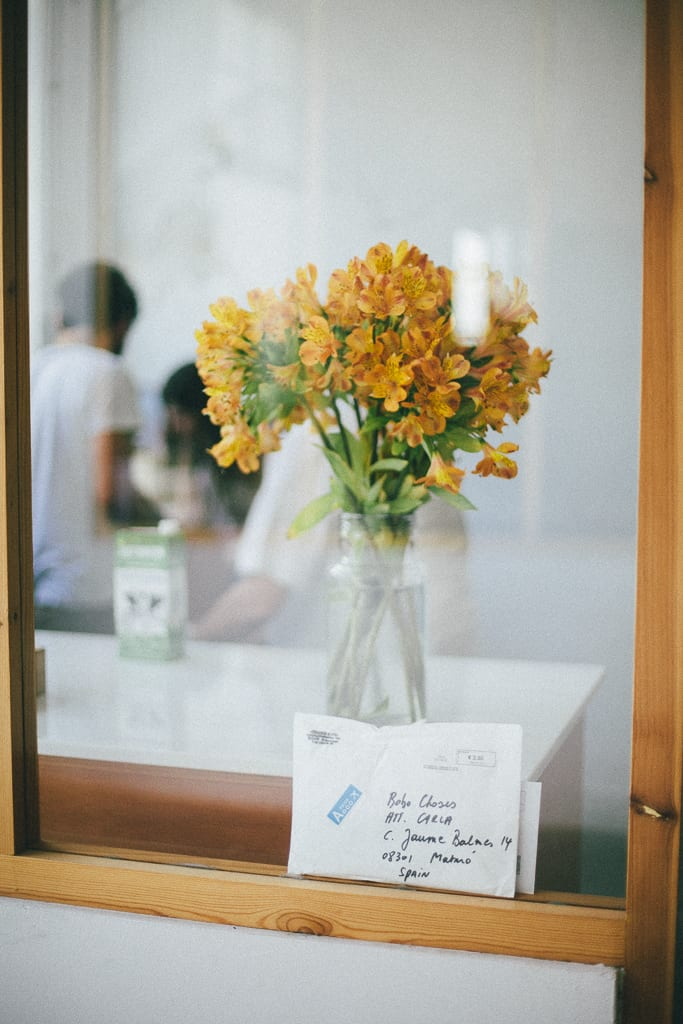 Flowers and mail at Bobo Choses work space